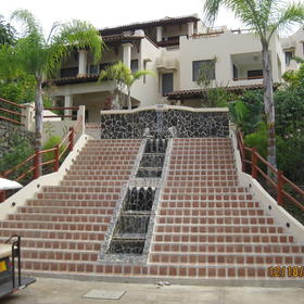 villa entrance. stairs with fountain