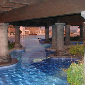 Jacuzzi, attached to pool and bar