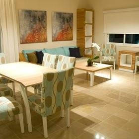 Presidential Suites by Lifestyle Holidays Vacation Resort Dining and Living Area
