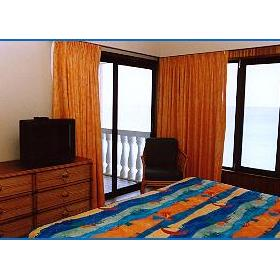 Unit master bedroom with balcony access