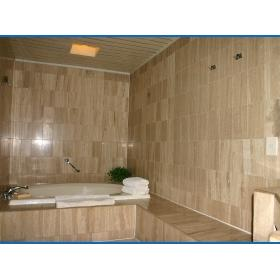 Unit master bathroom with large whirlpool tub and separate shower