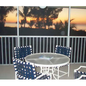 Tortuga Beach Club - Screened porch at sunset