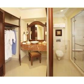 "Spacious marble bathrooms featuring ocean view twin showers – one with rain shower & multiple body massage jet sprays & the other with hand held ""telephone shower"" and ""His and Hers"" sinks, lighted vanity mirror, hairdryer and deluxe bathroom amenities"